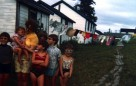 Beulah with children at worker accommodations, Caribou, 1971